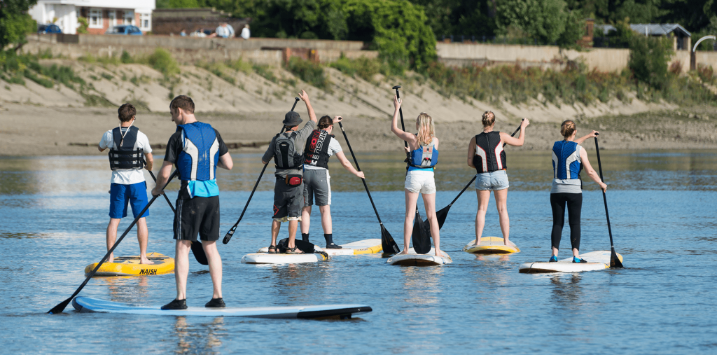 Stand up paddleboarders on the tidal River Thames